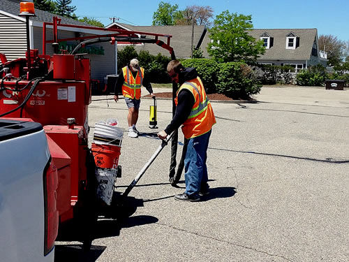 Pin Point Line Striping & Marking - NH Asphalt Crack Sealing